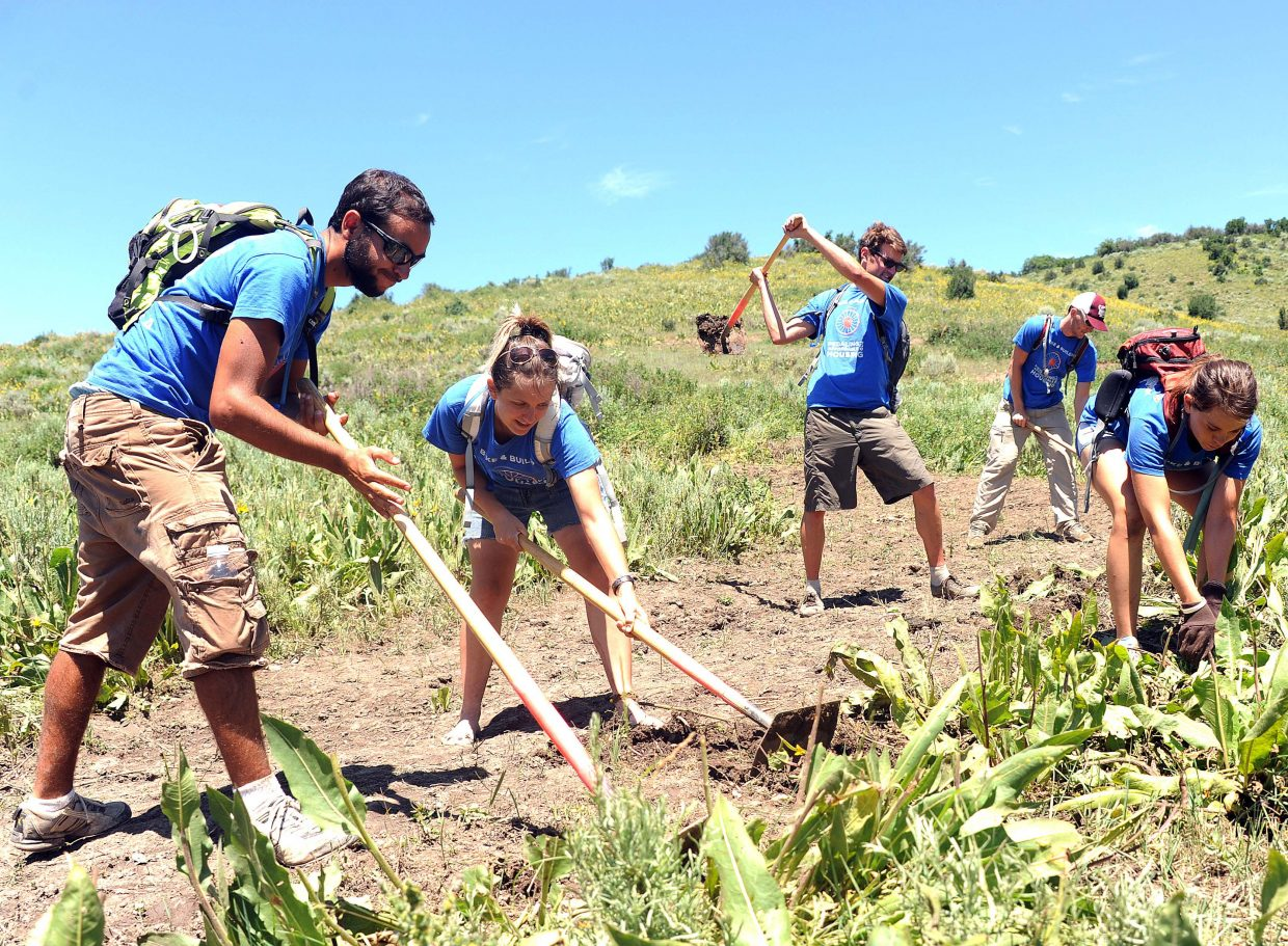 Volunteers work on the Rotary Trail near Steamboat Springs in July 2011. On Saturday, Routt County Riders is hosting a trail-building school, which will include classroom and field instruction.