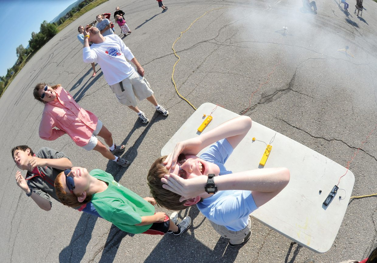 Eleven-year-old Walt Hellyer looks to the heavens after launching his model rocket from the Meadows Parking Lot during the Rocketry Camp, which was put on by the Steamboat Springs Arts Council's Young at Art summer program.