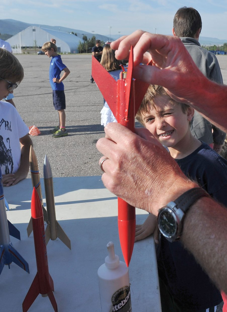 Wally Magill watches with interest as the power behind his rocket is connected by Soda Creek third-grade teacher Chris Kramer during the Rocketry Camp, which was put on by the Steamboat Springs Arts Council's Young at Art summer program.