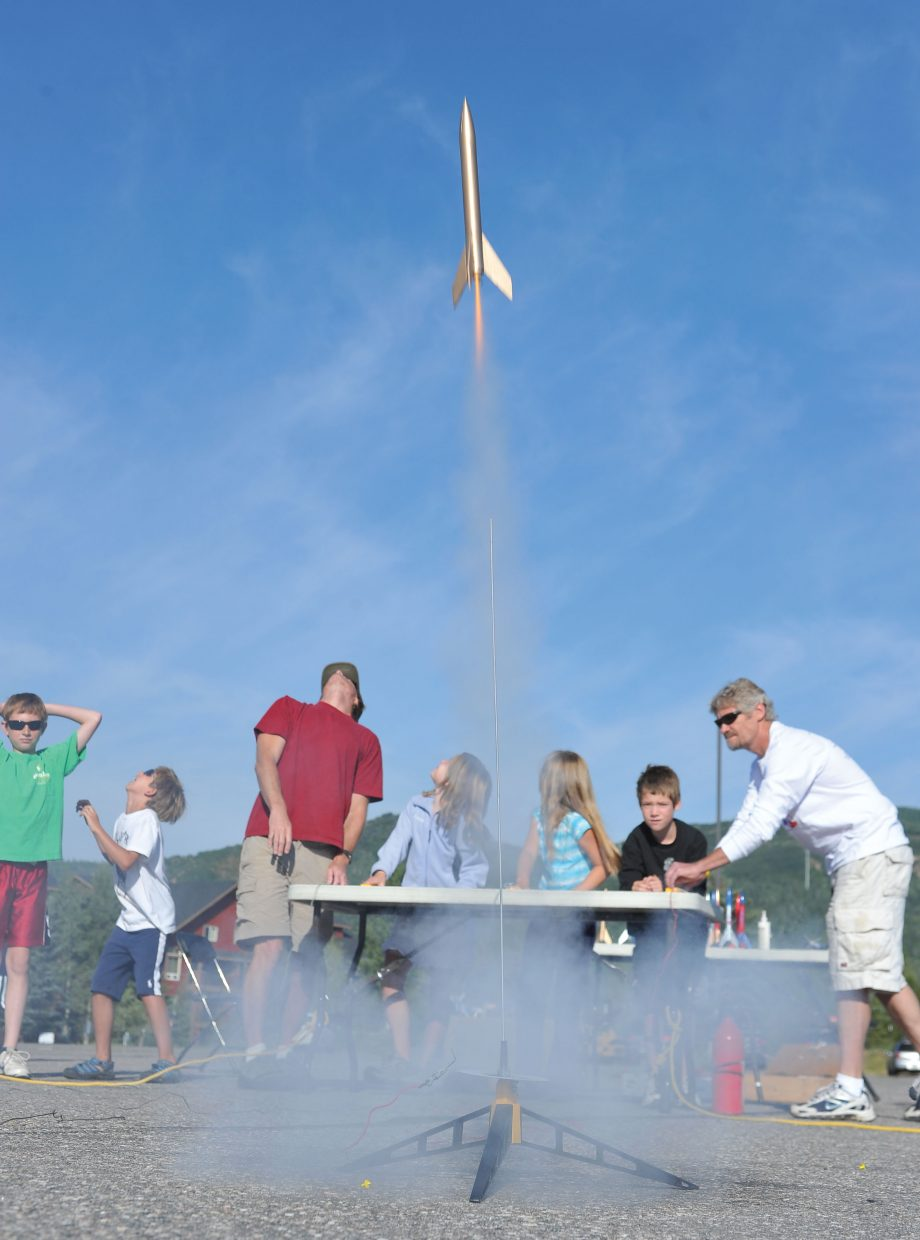 Students, teachers and parent volunteers look skyward as rockets are launched toward space as part of the Rocketry Camp, which was put on by the Steamboat Springs Arts Council's Young at Art summer program.