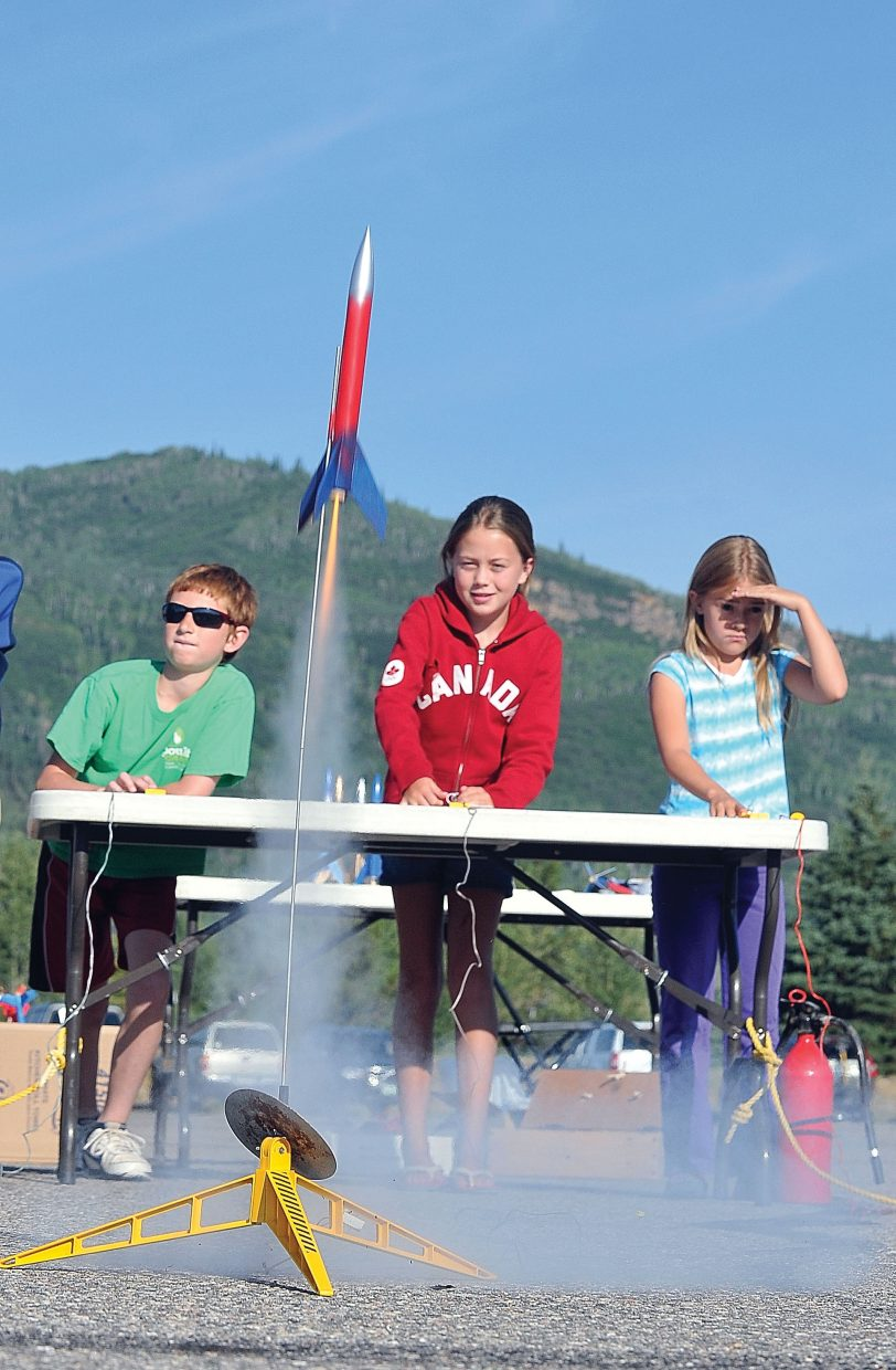 Alicia Mitchell, wearing red, watches as her rocket is launched high into the sky as part of the Rocketry Camp, which was put on by the Steamboat Springs Arts Council's Young at Art summer program.