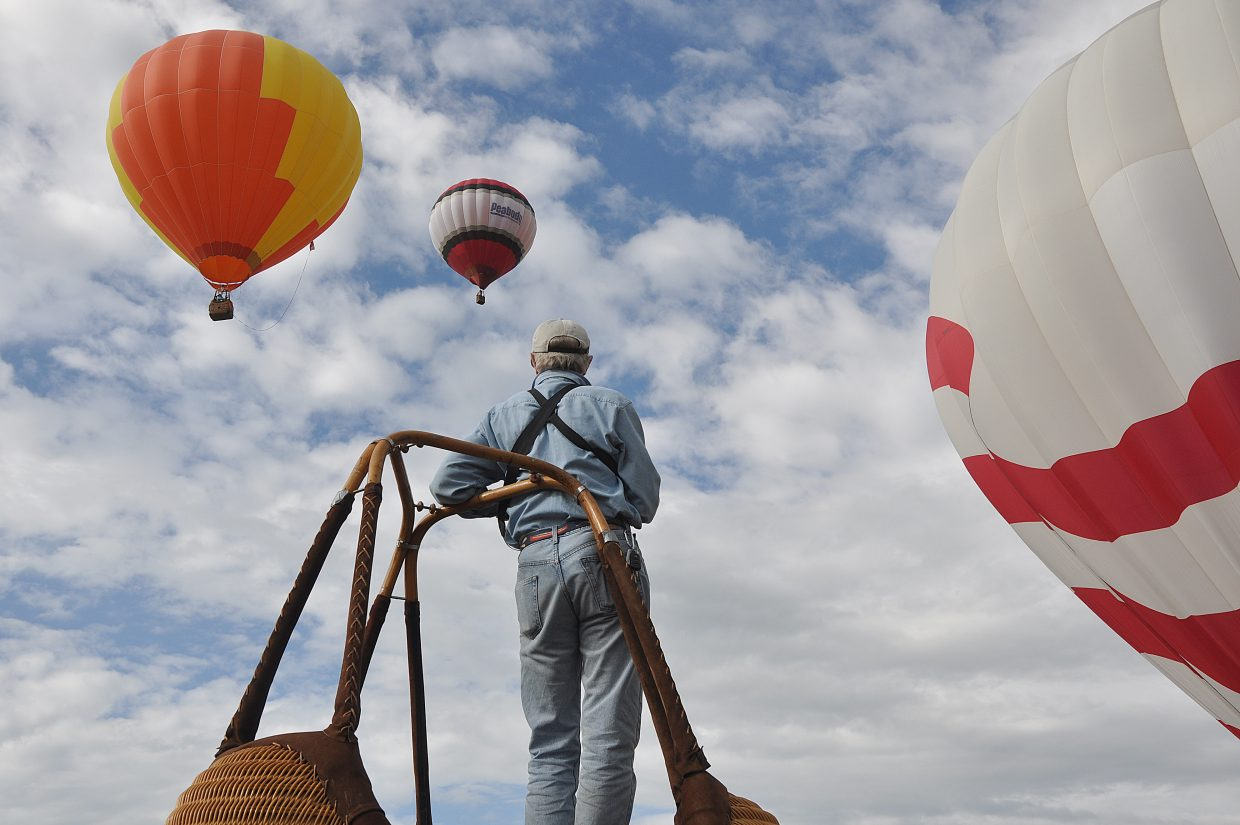 David Moulton had a good view of the balloons from the top of a basket on Saturday at Bald Eagle Lake.