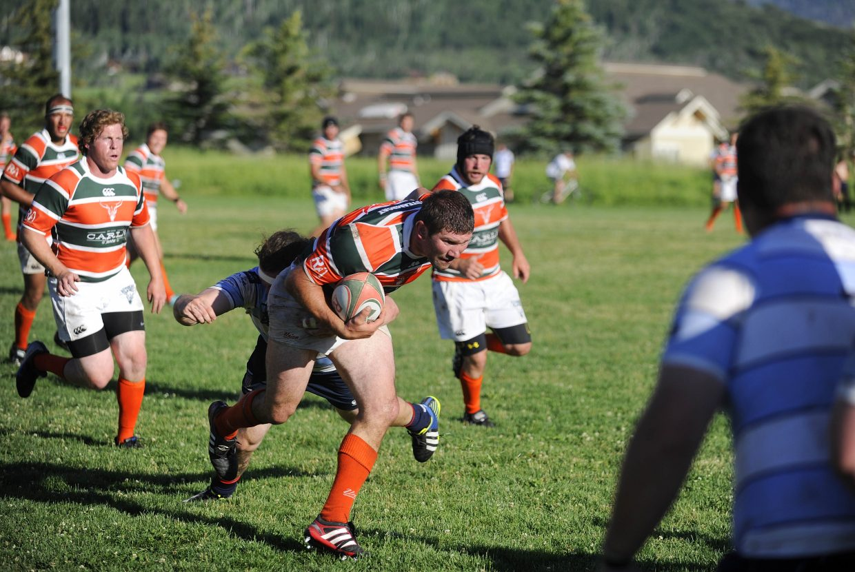 Nick Nespeca breaks a tackle during the semifinal match of the Cowpie Classic rugby tournament Saturday at Ski Town Fields.