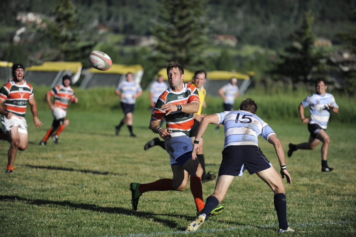Matt Kelly, of Chicago, plays for the Steamboat Springs rugby team Saturday during the Cowpie Classic tournament at the Ski Town Fields.