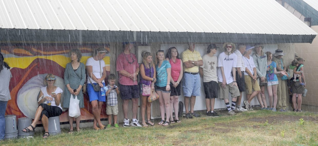 People looked for shelter as a stormed rolled through the Art in the Park event Saturday at West Lincoln Park.