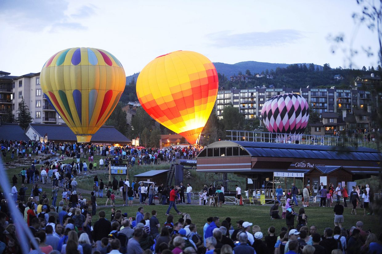 Hot air balloons light up Saturday evening at the base of Steamboat Ski Area.