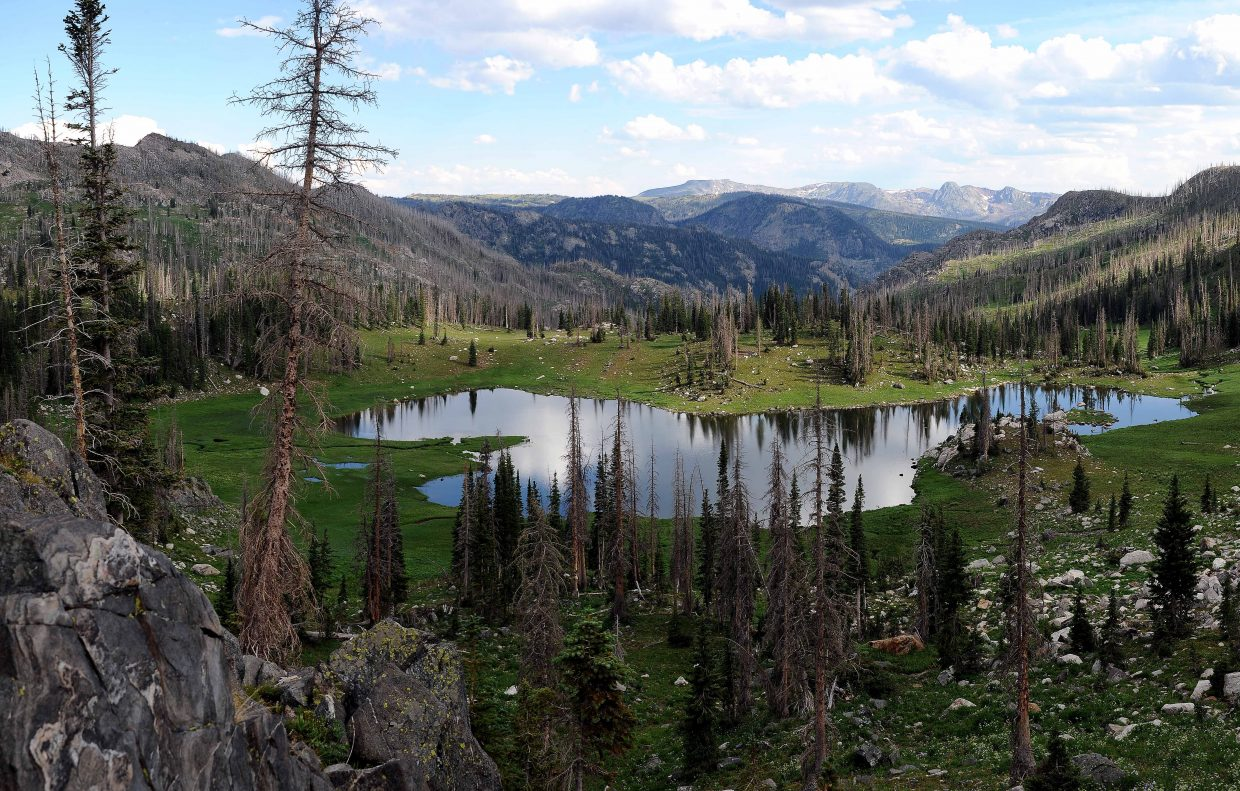 Mica Lake stands nearly 2,000 feet above the trailhead, and it's not an easy hike. Despite the ravages of beetles, blowdowns and fires, the view still is stunning.