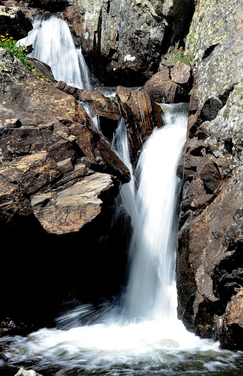 A waterfall dumps into a pool along the route to Mica Lake.