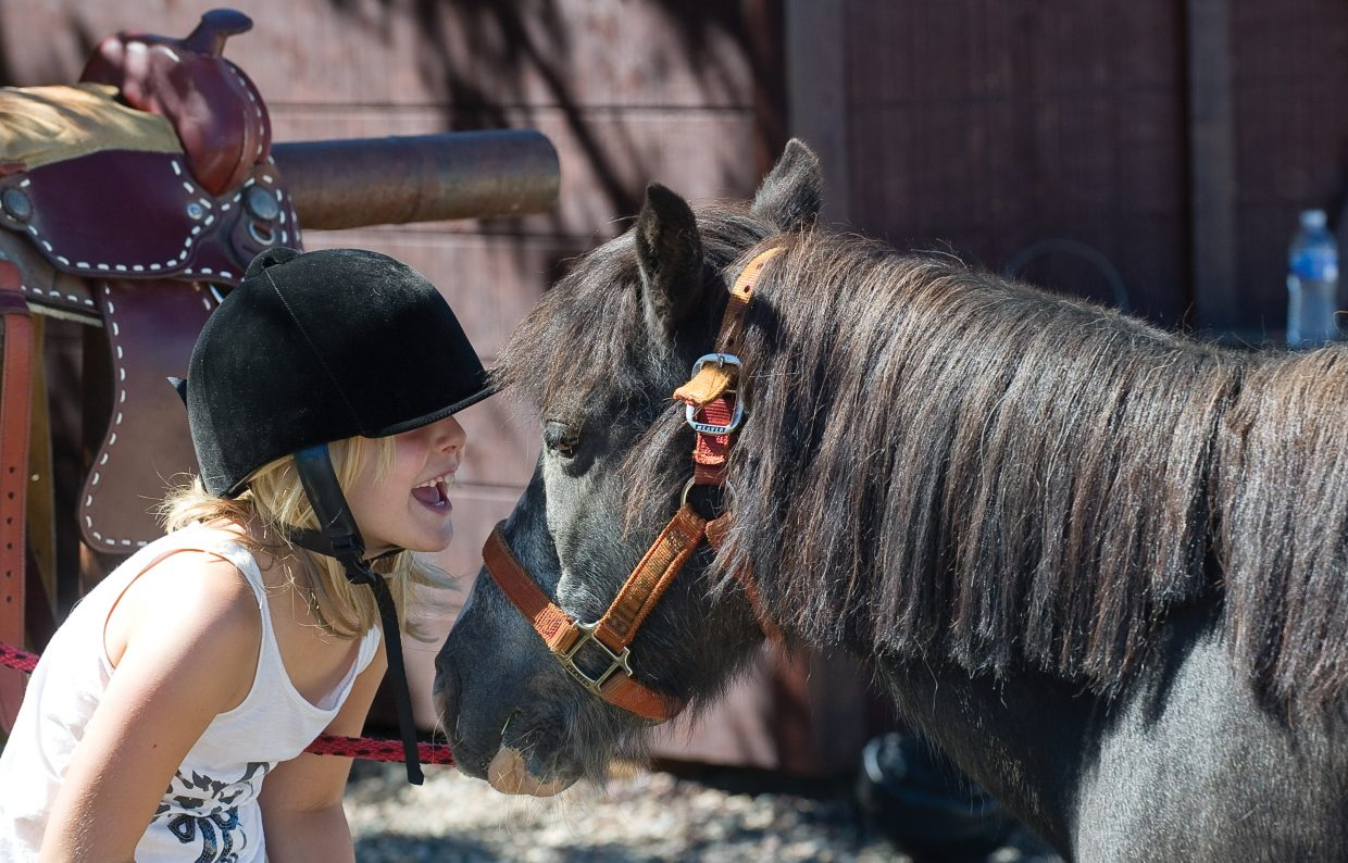 Nine-year-old Ava Scarbourgh makes friends with Billy Bob, a Welsh Pony, at a horseback riding camp sponsored by the city of Steamboat Springs Parks, Open and Recreational Services Department at the CR Summit Riding Club just outside of Steamboat Springs.