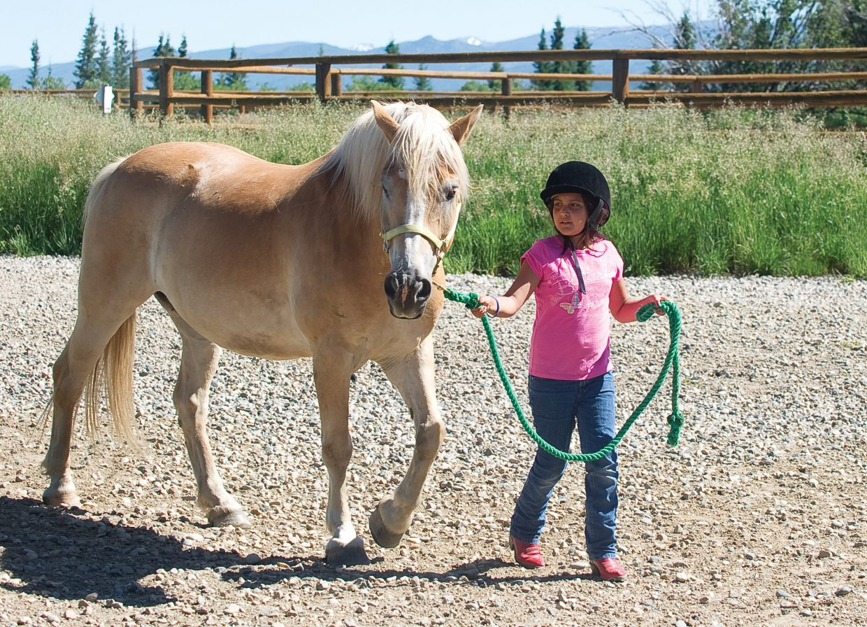 Samantha Marten leads Benny Buttons during a horseback riding camp sponsored by the city of Steamboat Springs Parks, Open and Recreational Services at the CR Summit Riding Club.