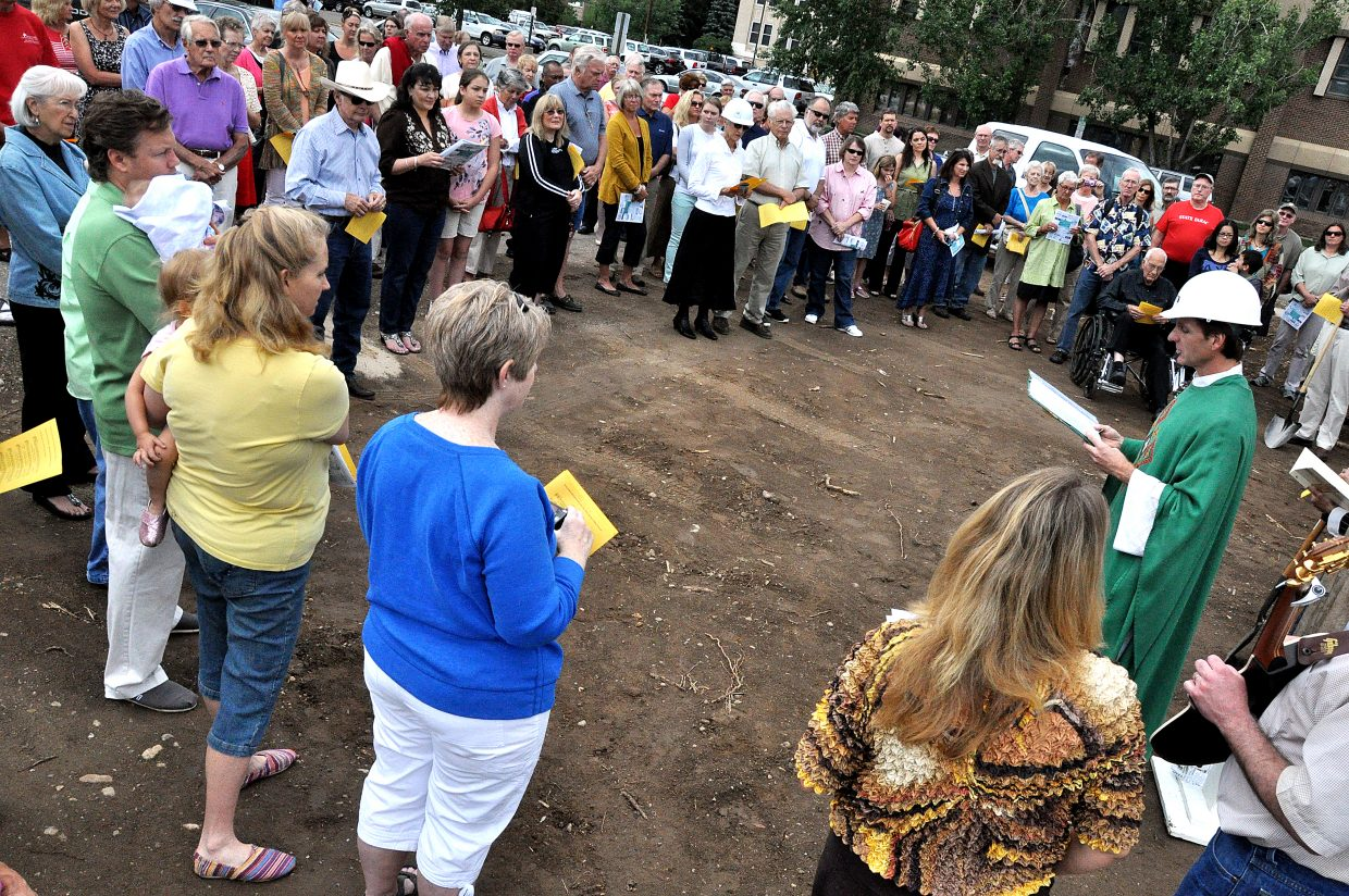 The Rev. Ernest Bayer leads a groundbreaking ceremony Sunday morning at the site of Holy Name Catholic Church's expansion project. Bayer said Fox Construction will start building the 15,382-square-foot addition to the church in Old Town sometime this week.