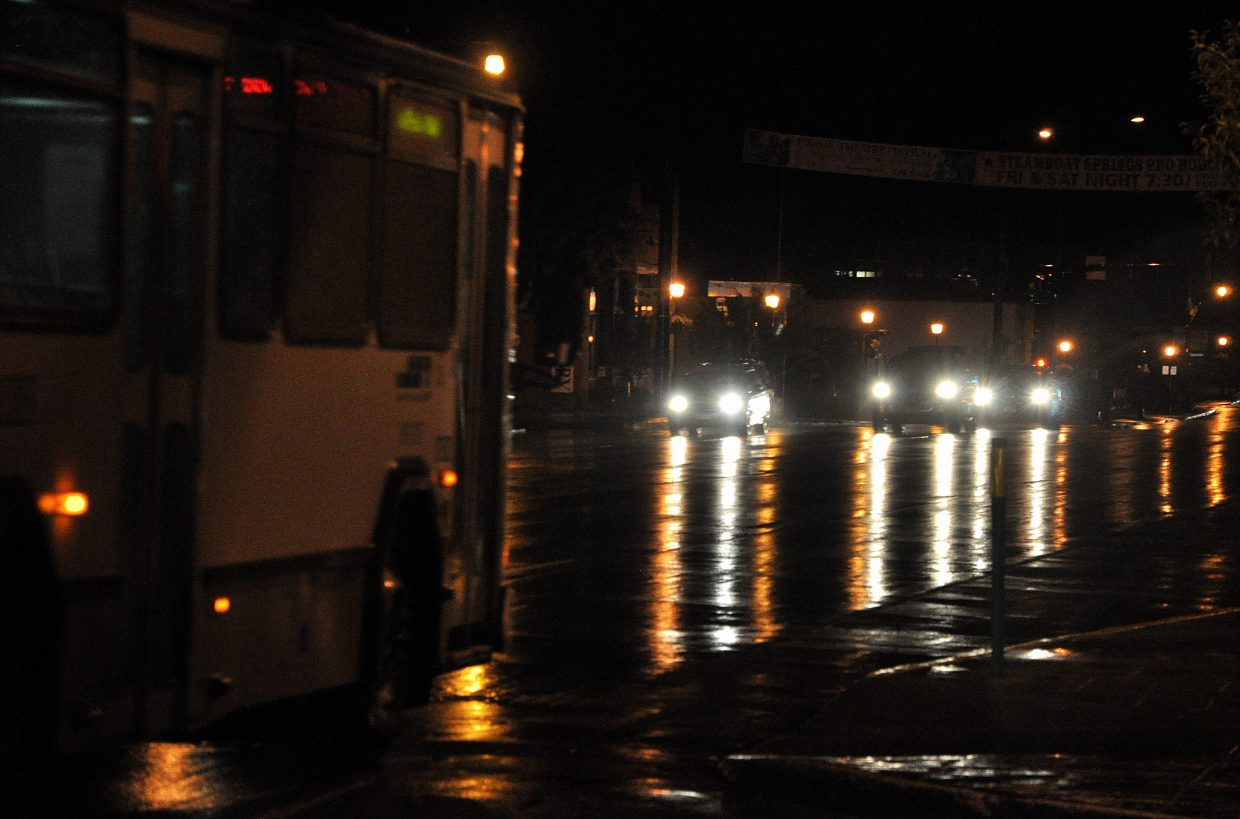 Traffic moves down a wet Lincoln Avenue on Saturday night. A lingering storm dropped a quarter of an inch of rain Saturday on Steamboat, and more precipitation is forecast for the Yampa Valley this week.