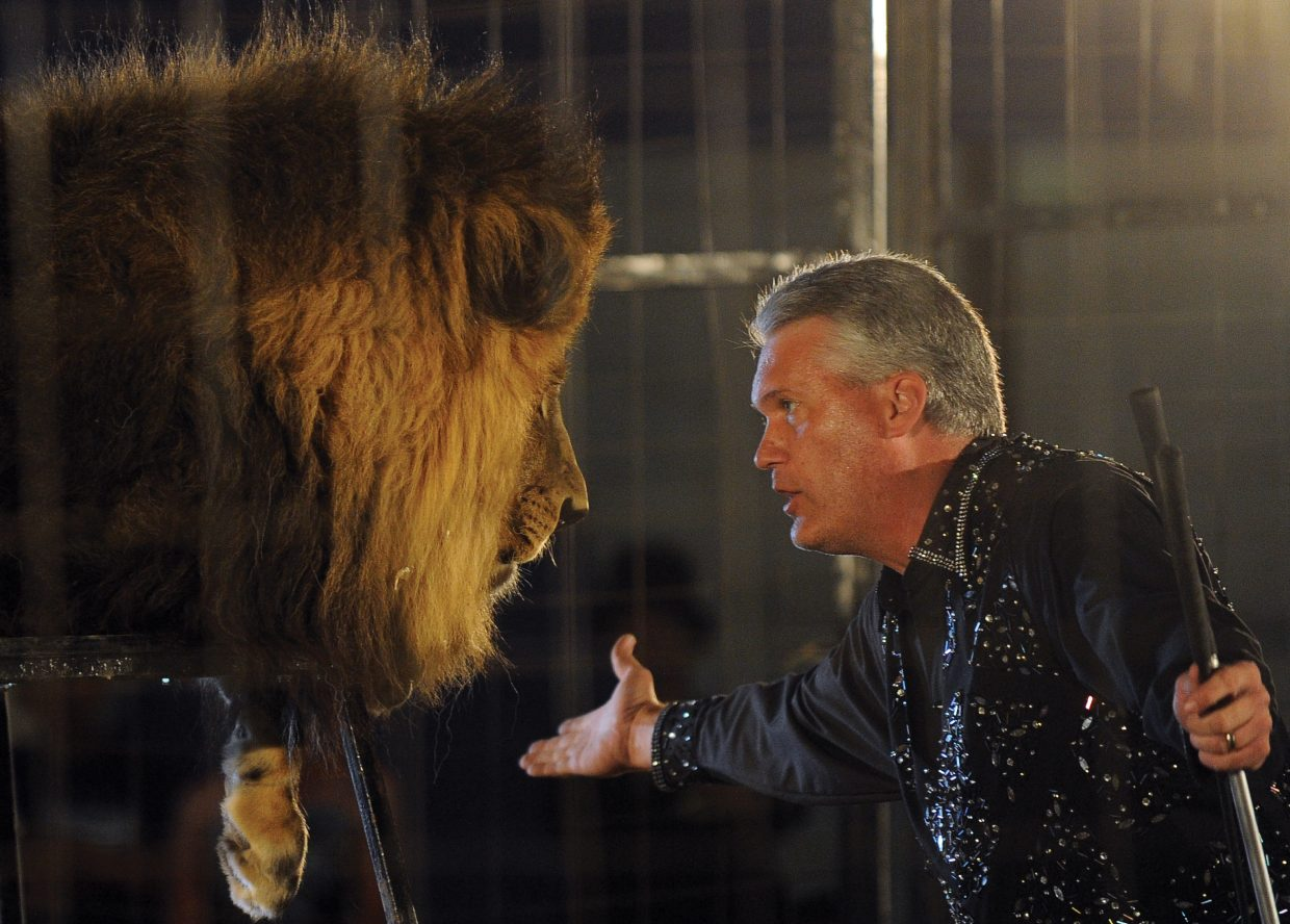 Trey Key pleads with a lion during the cat act at he first performance of the Culpepper & Merriweather Circus Monday afternoon at the rodeo grounds in Steamboat Springs. The circus has performances at 5 p.m. and 7:30 p.m. Tuesday in Steamboat before packing up and heading to Kremmling.