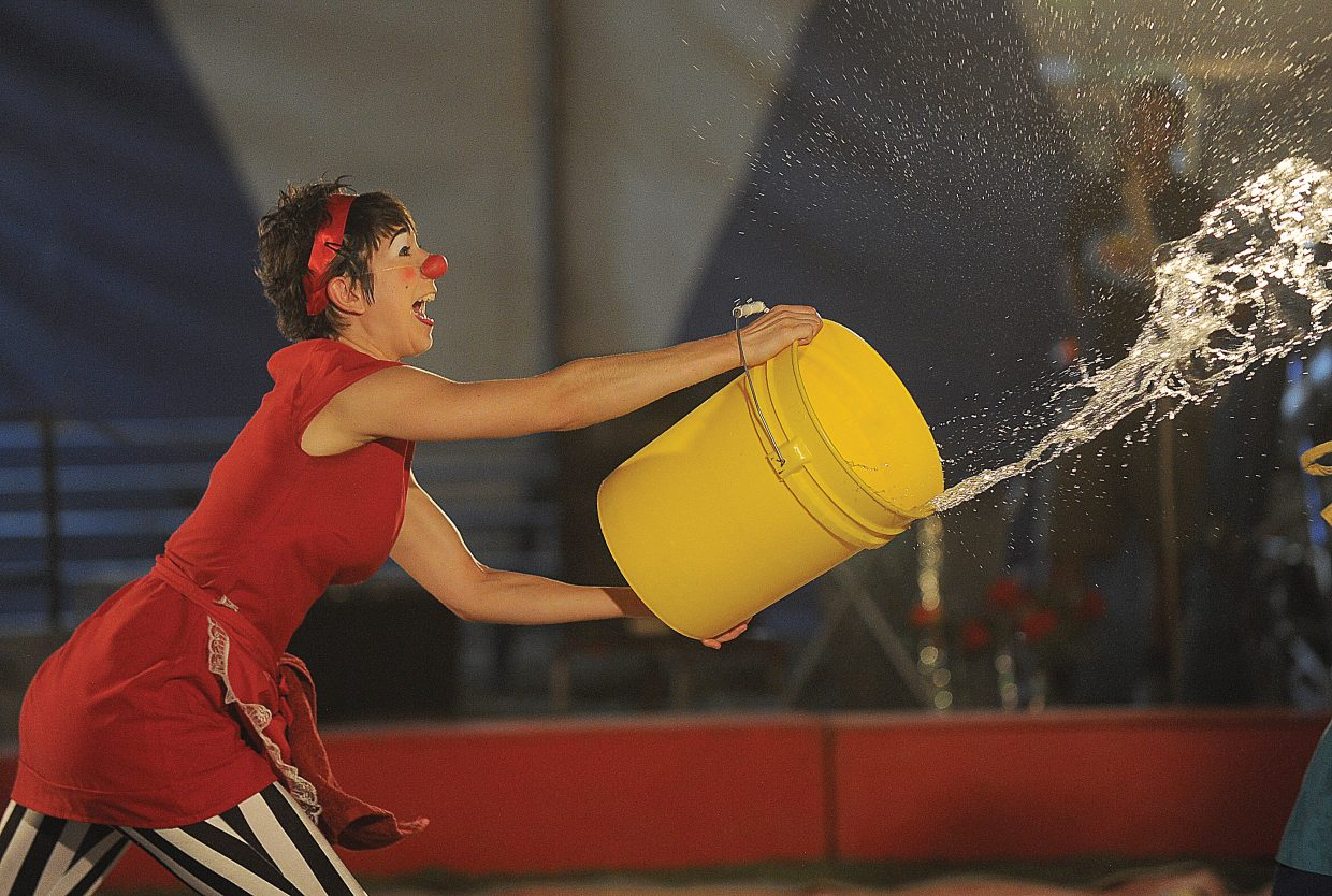 Circus clown Michelle Musser throws water onto her counterpart Nathan Holguin (who perform as Judy & Punchy) during first performance of the Culpepper & Merriweather Circus Monday afternoon at the rodeo grounds in Steamboat Springs. The circus has performances at 5 p.m. and 7:30 p.m. Tuesday in Steamboat before packing up and heading to Kremmling.