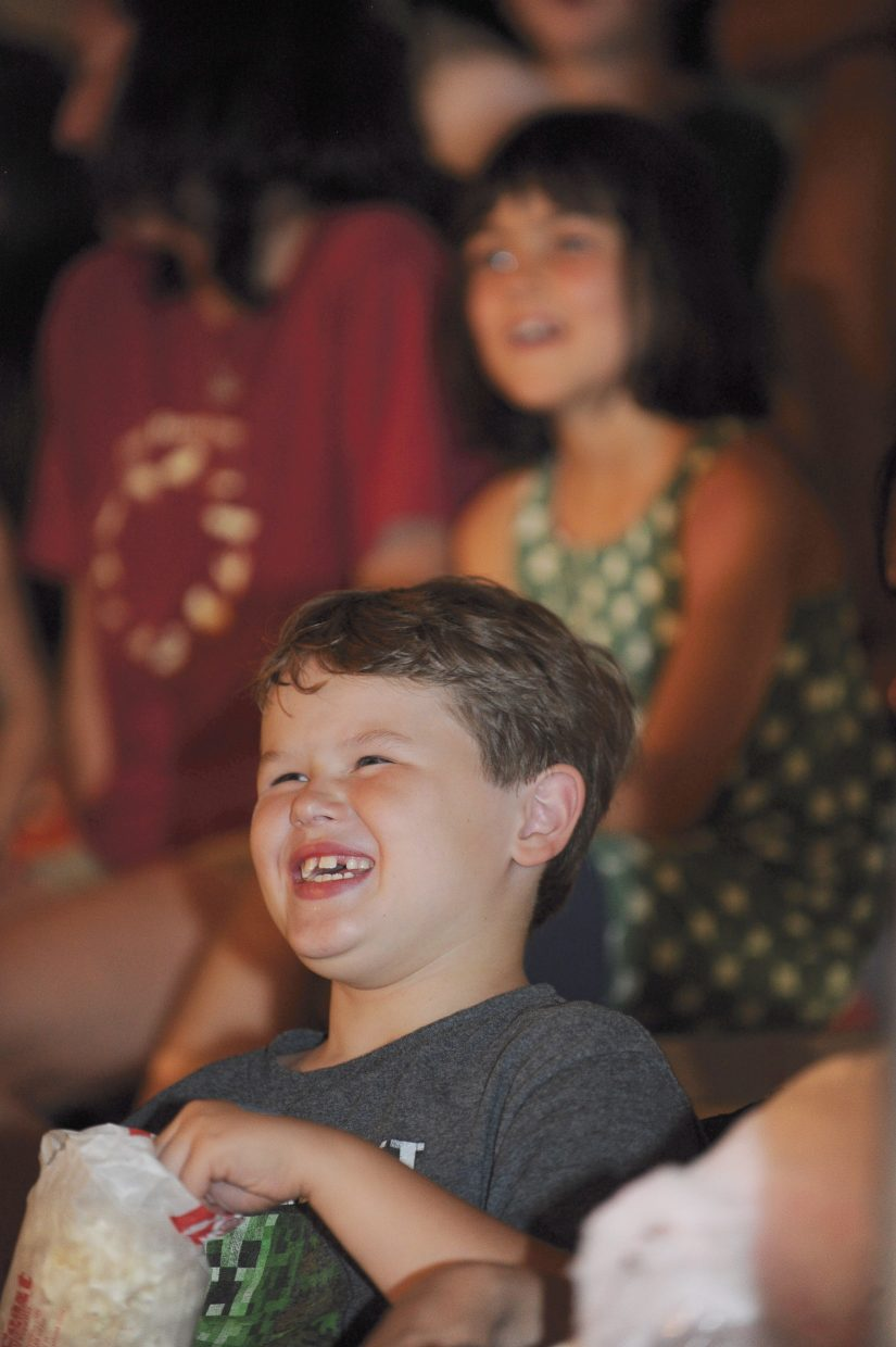 Eight-year-old Logan Truelove laughs at the clowns during the first performance of the Culpepper & Merriweather Circus Monday afternoon at the rodeo grounds in Steamboat Springs. The circus has performances at 5 p.m. and 7:30 p.m. Tuesday in Steamboat before packing up and heading to Kremmling.