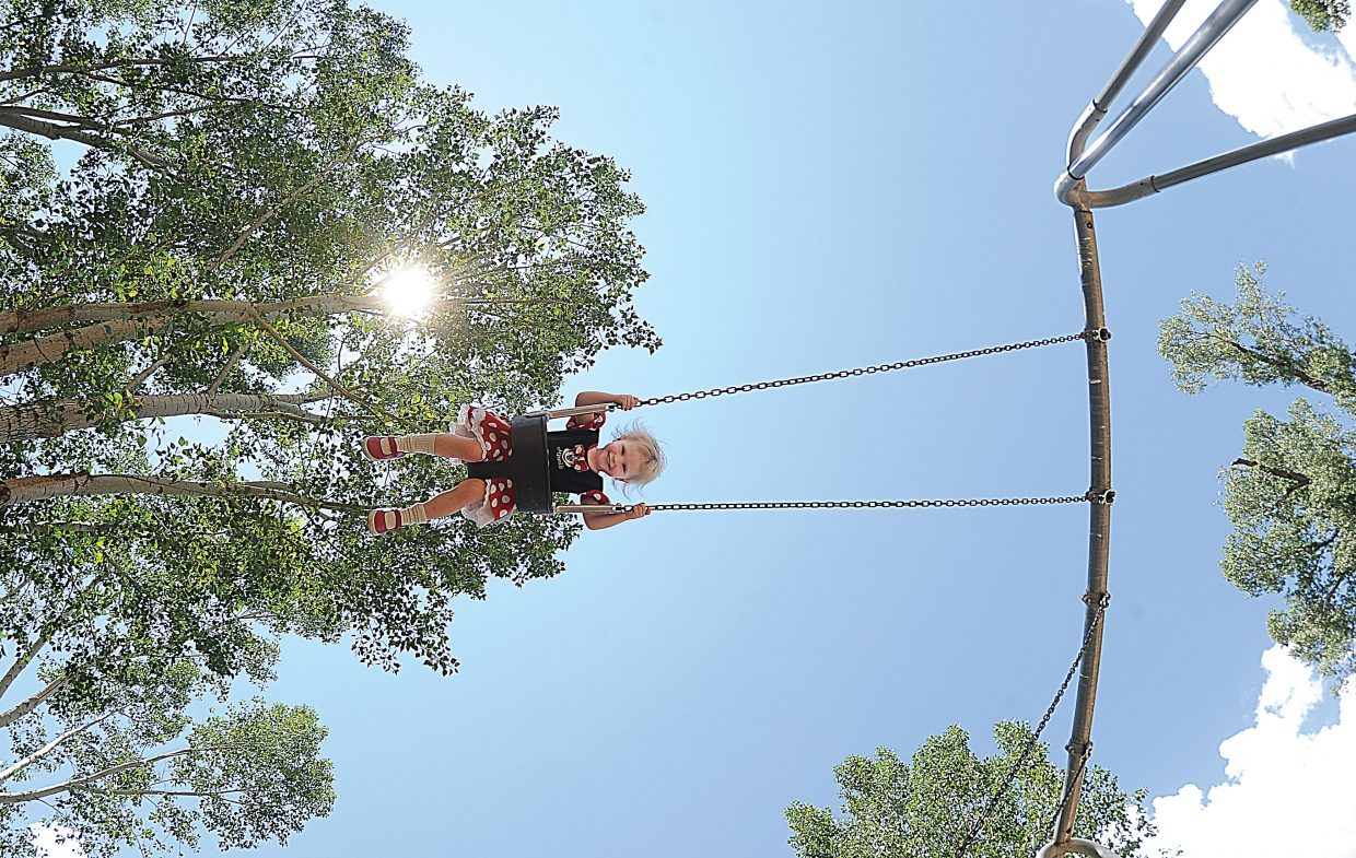 Two-year-old Casiah Clark reaches new heights as she swings at Little Toots park Monday afternoon.