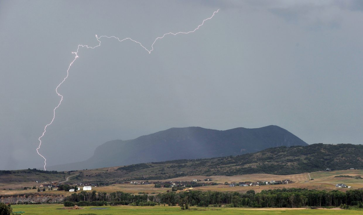 Lightning strikes a hillside near Steamboat II on Monday afternoon as a fast-moving storm makes its way through Steamboat Springs. A chance of thunderstorms remains in the forecast today before giving way to drier conditions and highs around 90 degrees Wednesday through Friday.