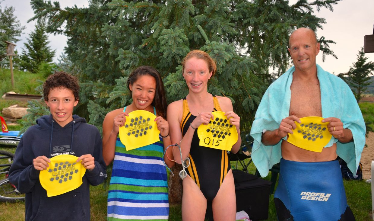 Lightning forced swimmers out of the water in Monday night's Bald Eagle Lake Open Water Swim. But a few swimmers managed to finish first. Half-mile winners are Tyler Terranova, of Steamboat, and 15-year-old Ruby Johnson, of Audubon, Iowa. Mile winners are Samantha Terranova and Scott Weir. It's the third week in a row for the Terranova kids to claim victory.
