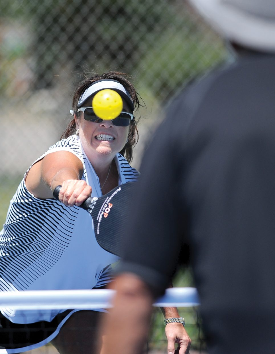 Michelle Diehl returns a shot from Gary Fey while playing pickleball Tuesday afternoon at Howelsen Hill. The city of Steamboat Springs recently painted pickleball lines on the tennis courts, and several members of the local Pickleball Club came out to play Tuesday.