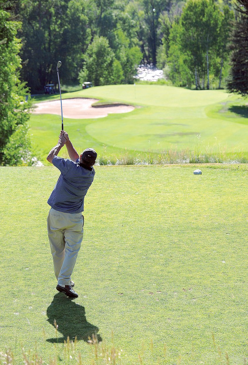 Doug Terry tees off Tuesday at Rollingstone Ranch Golf Club during this year's Rally for the Cure golf tournament.