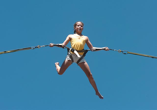 Kayla Blosser hangs on tight while bungee jumping at Steamboat Ski Area on Friday afternoon. Blosser was with her family, who was visiting Steamboat Springs from Wheat Ridge.