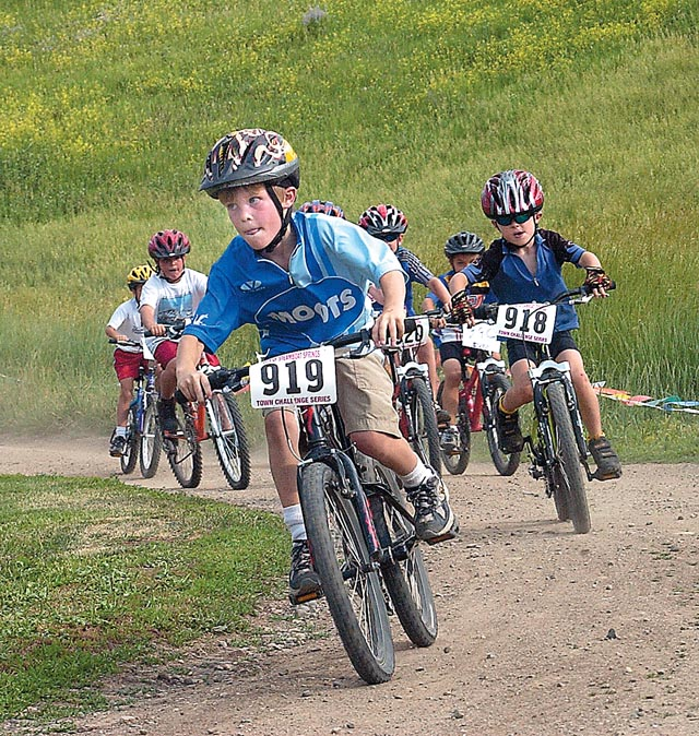 Koby Vargus, 7, takes the lead on the first turn of a race held at Howelsen Hill last July. This week's race, Another Root Canal, will be the fifth race in Steamboat's eight race Town Challenge series, and welcomes riders of all ages.