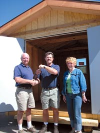 Ray Dix, manager of mechanical and civil training at the TIC Training Facility in Steamboat Springs, hands keys to a new storage shed built by TIC students to Jim Severson, left, Friday morning at the facility. As maintenance manager for the Routt County Foundation of Senior Citizens, Severson will use the shed for storing tools and lawn care equipment. Geneva Taylor, at right, is treasurer and assistant secretary for the foundation's board of directors.