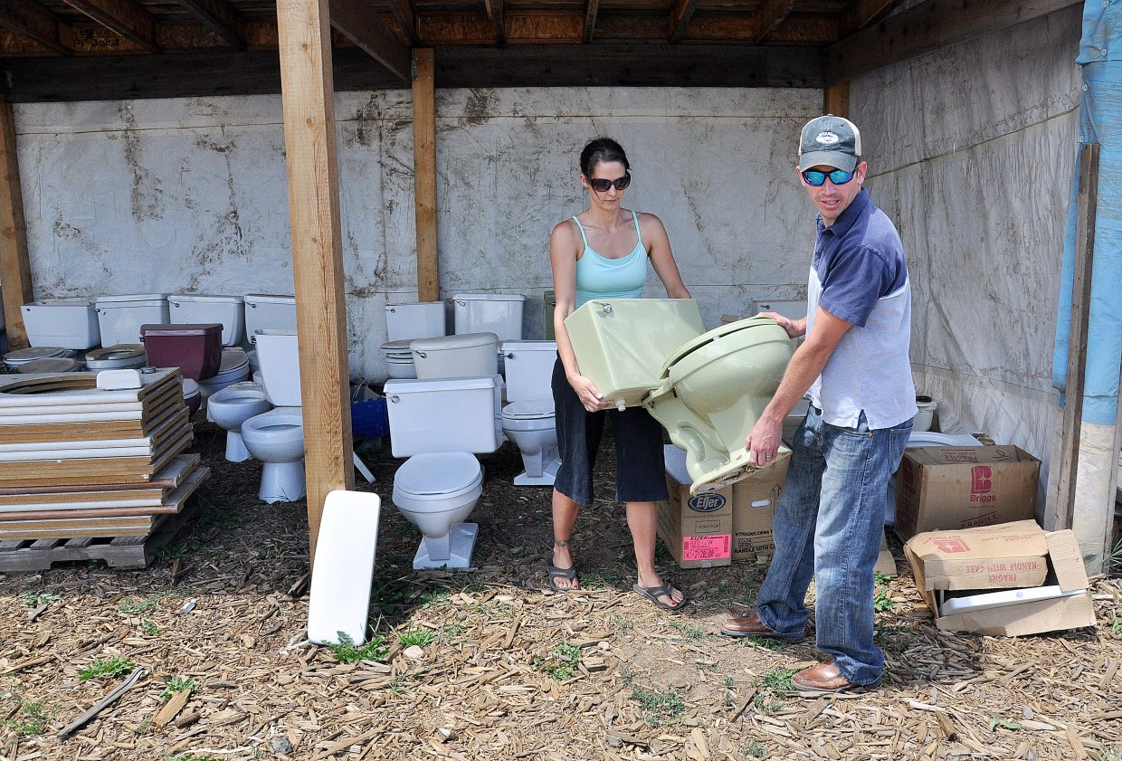 Travis and Deanna Mathey pick out a toilet Wednesday near the Milner Landfill that will be used in the Routt County Redneck Olympics on Saturday in Hayden.