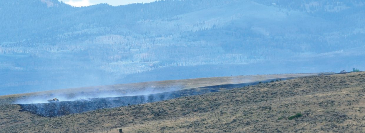 Wildfire crews battle a grass fire northwest of Hayden on Wednesday afternoon. Between 2 and 2:30 p.m. Wednesday, the Routt County Sheriff's Office and Routt County Emergency Manager Bob Struble were on their way to a wildfire that reportedly began during haying operations in a field on Routt County Road 78 northwest of Hayden on the way to Elkhead Reservoir. The location is near the triangle intersection with C.R. 78A. There was a report of a visible column of black smoke, and an area resident said he watched the size of the fire triple in about 10 minutes. The fire was contained at about 6 p.m. The cause has not been determined, but equipment use is suspected as the ignition source. The West Routt Fire Protection District and Bureau of Land Management also responded.
