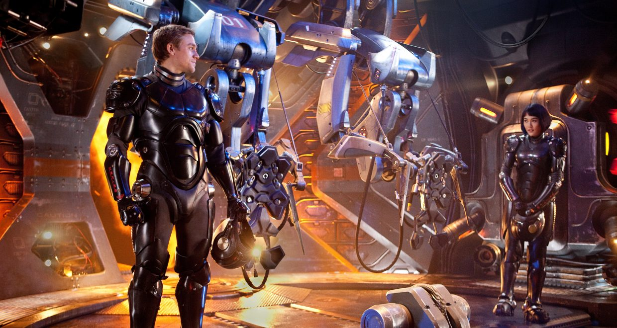 """Jaeger pilots Raleigh Becket (Charlie Hunnam) and Mako Mori (Rinko Kikuchi) prepare for battle in """"Pacific Rim."""" The movie is about a near future where giant robots are used to fight an onslaught of monsters rising from the Pacific Ocean."""