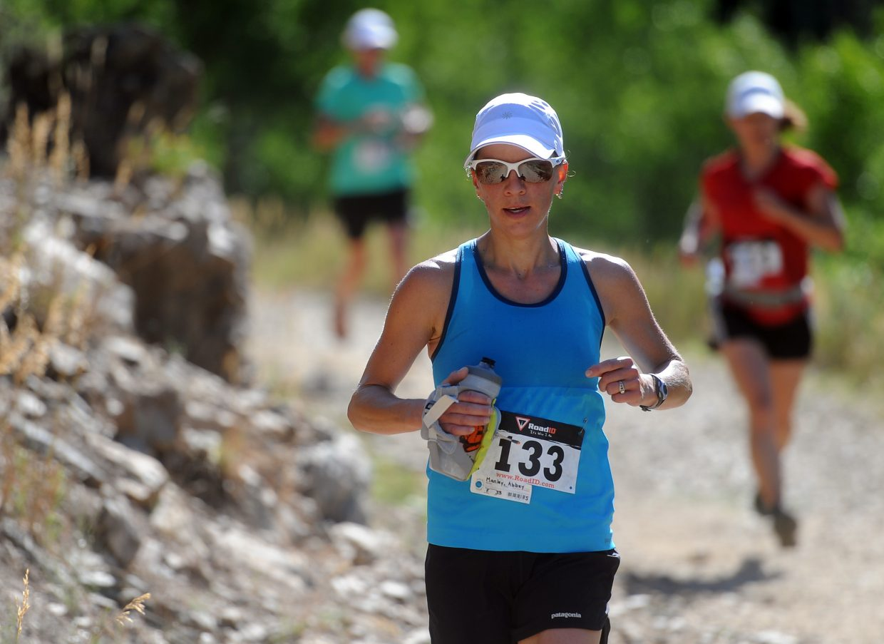 Abbey Manley runs in the Spring Creek Memorial 9-mile race in July 2012. This year's race begins at 8 a.m. Saturday at the Spring Creek Trail.