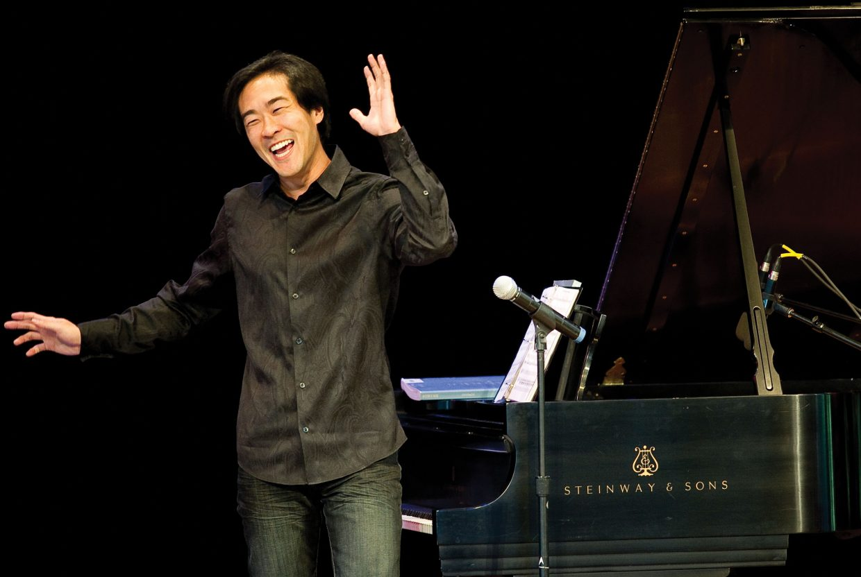 Musician Alpin Hong enjoys a laugh with the audience during Tuesday's youth concert at Strings Music Pavilion. Hong, who entertained the crowd on the piano, appeared along with percussionist Simon Boyar and singer Jessica Tivens in the daytime show.