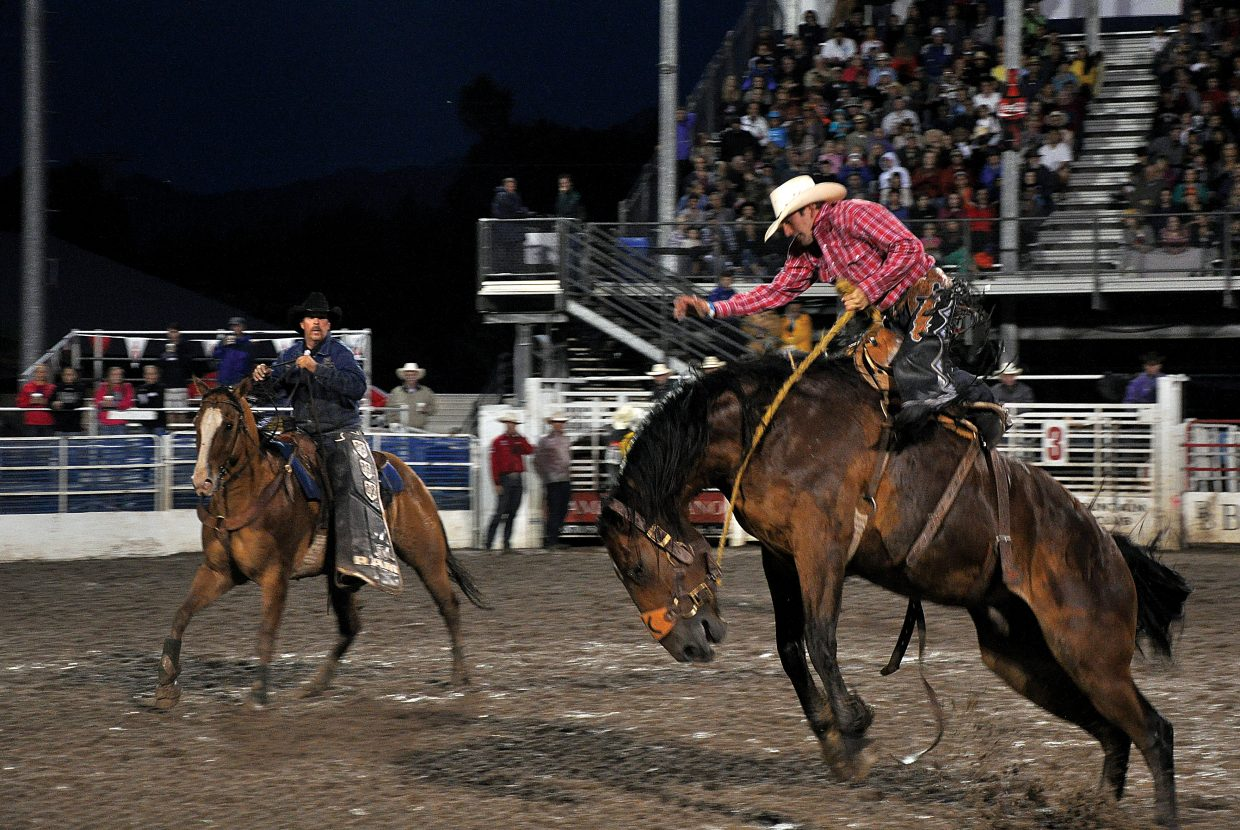 A saddle-bronc rider hangs on tight last Saturday at the Steamboat Springs Pro Rodeo series. The rodeo continues at 7:30 p.m. Friday and Saturday.