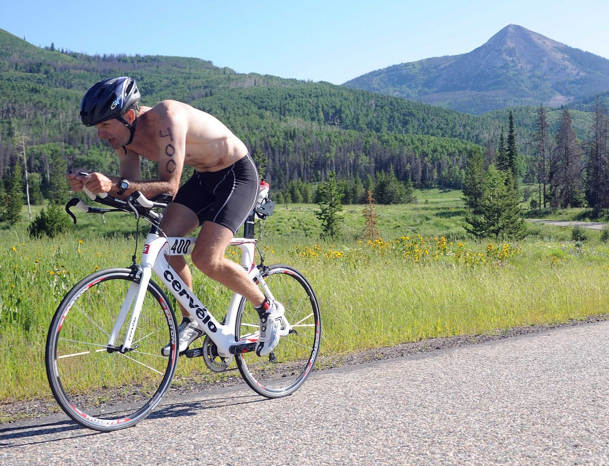 David Gower rides in last year's inaugural Steamboat Lake Sprint Triathlon. The event returns Sunday but is sold out.