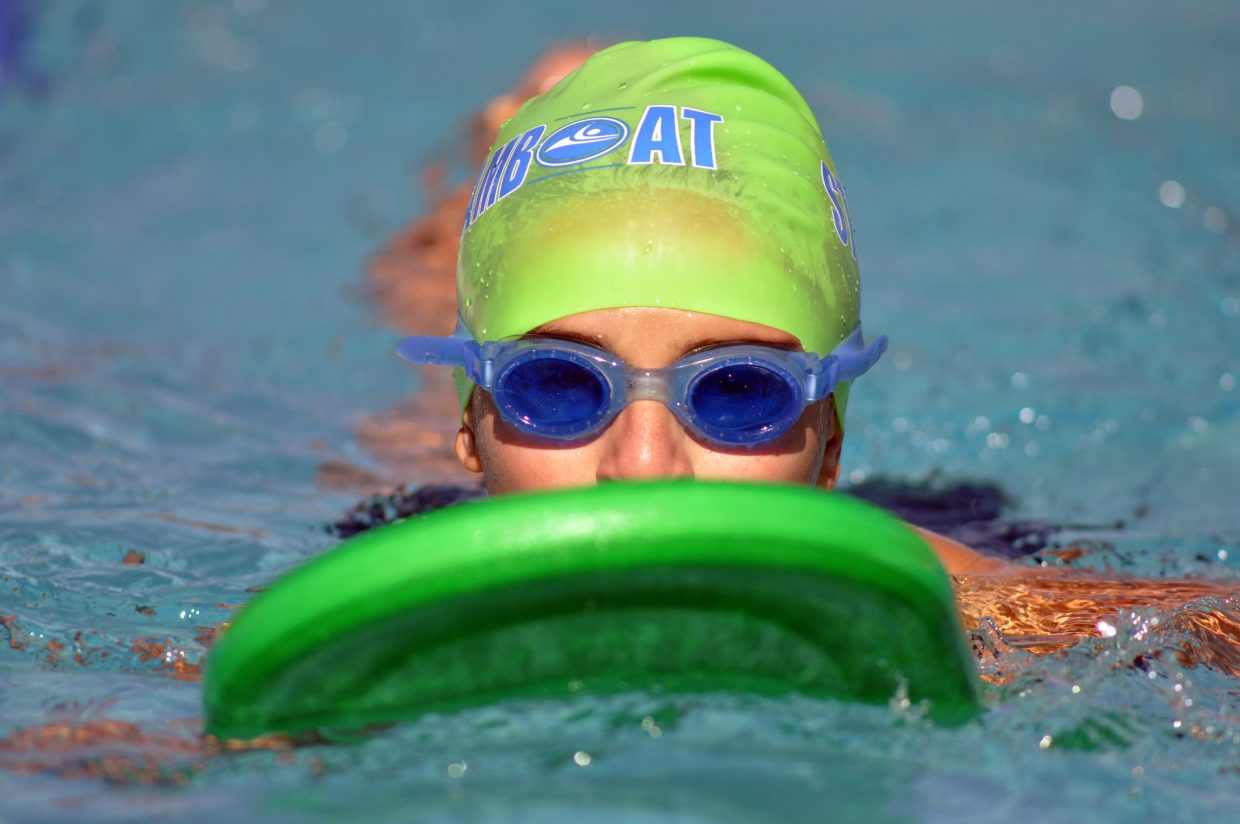 Tyler Paoli practices swimming Friday at Old Town Hot Springs.