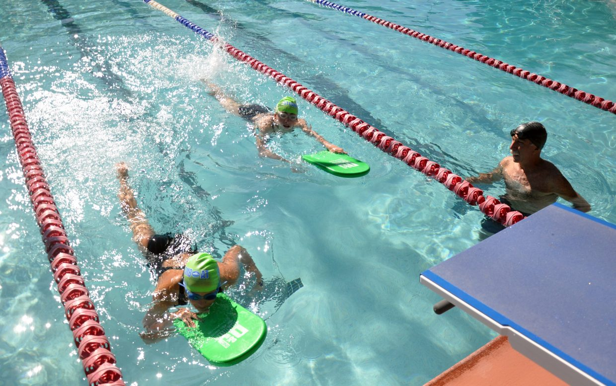 Coach David Franzel leads a swimming practice Friday morning at Old Town Hot Springs.
