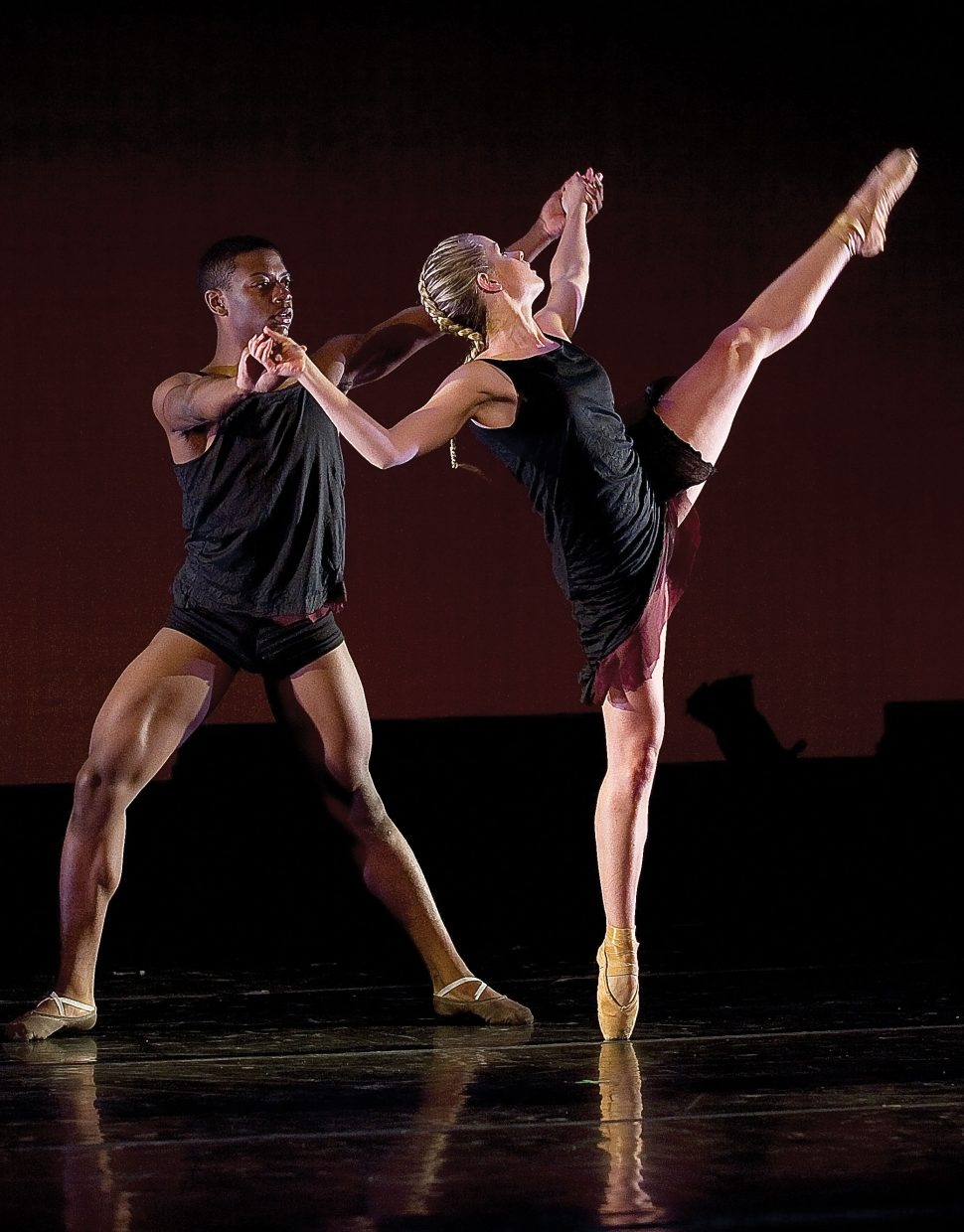 "Dancers Ellie Swiatkiwsky and Nehemiah Spencer perform ""Slow Falling"" a dance choreographed by Rick McCullough that will world premiere at this weekend's Evening of Dance."