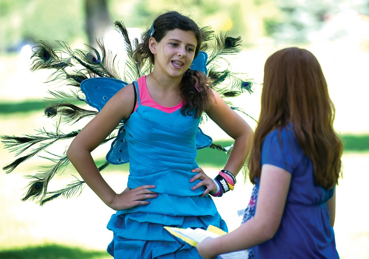 Ellie Kavanaugh, left, performs a scene in an original play with Miriah Walker Wednesday afternoon in West Lincoln Park. The young actors were taking part in a workshop that is part of the Kaleidoscope summer camp program. The workshop featured members of the cast of the Piknik Theatre directing the young students in an original play.