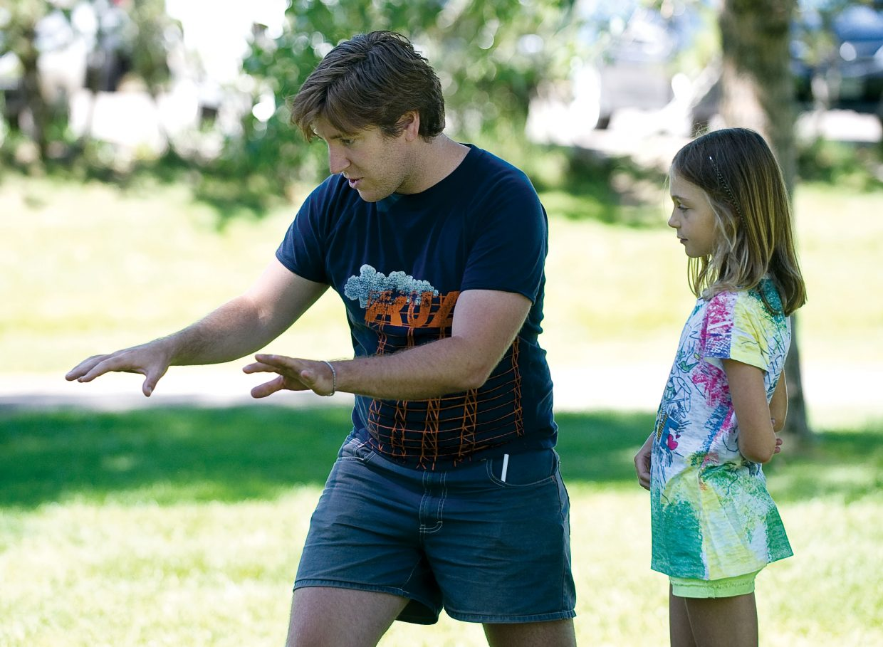 Piknik Theatre actor Adam Donald describes what he wants to see from young actor Alison Famulare while rehearsing a scene of a play in West Lincoln Park Wednesday. The scene was part of an acting workshop put on by the Kaleidoscope summer camp.