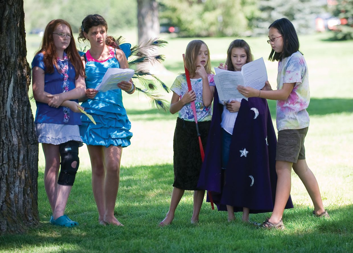 Young actors, from left to right, Miriah Walker, Ellie Kavanaugh, Alison Famulare, Emma Cooke and Zoe Stewart work on a scene for a play Wednesday in West Lincoln Park. The play was part of Kaleidoscope summer camp that featured acting workshop with the members of the cast of the Piknik Theatre.