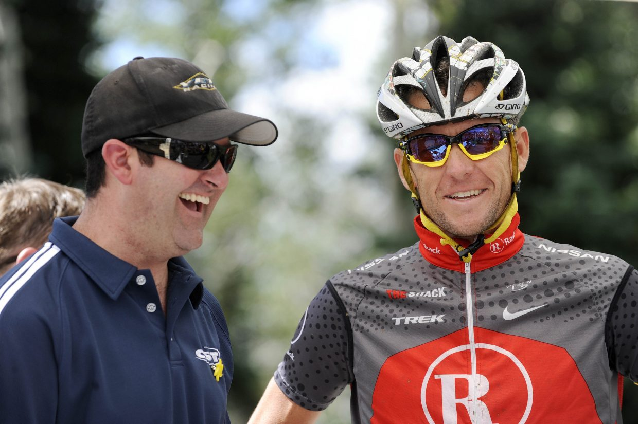 Steamboat Springs cancer survivor Brad Cusenbary and seven-time Tour de France winner and cancer survivor Lance Armstrong share a laugh during the 2010 Ride 4 Yellow event.