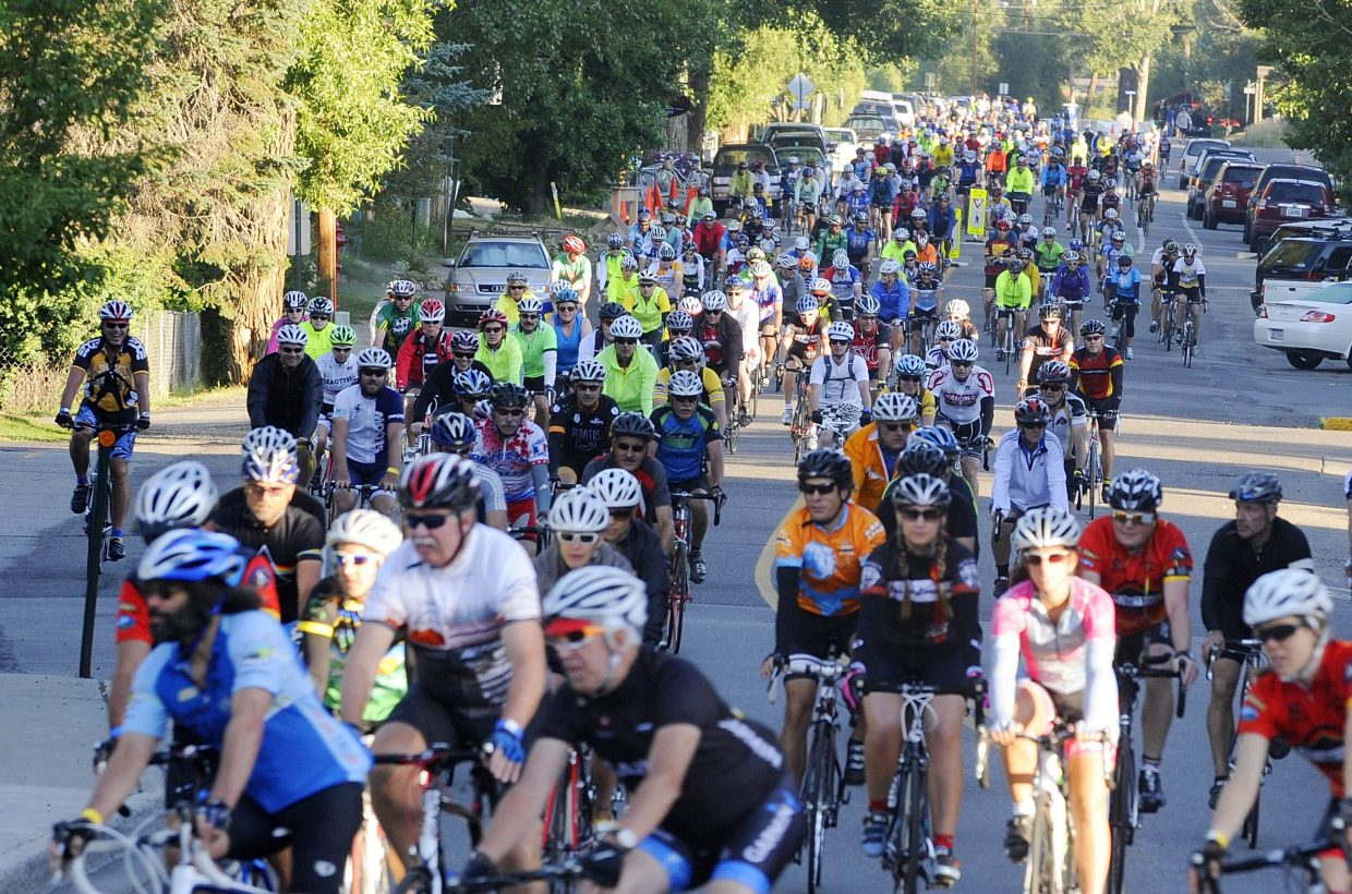 Cyclists roll out on Yampa Street at the start of Saturday's Tour de Steamboat.