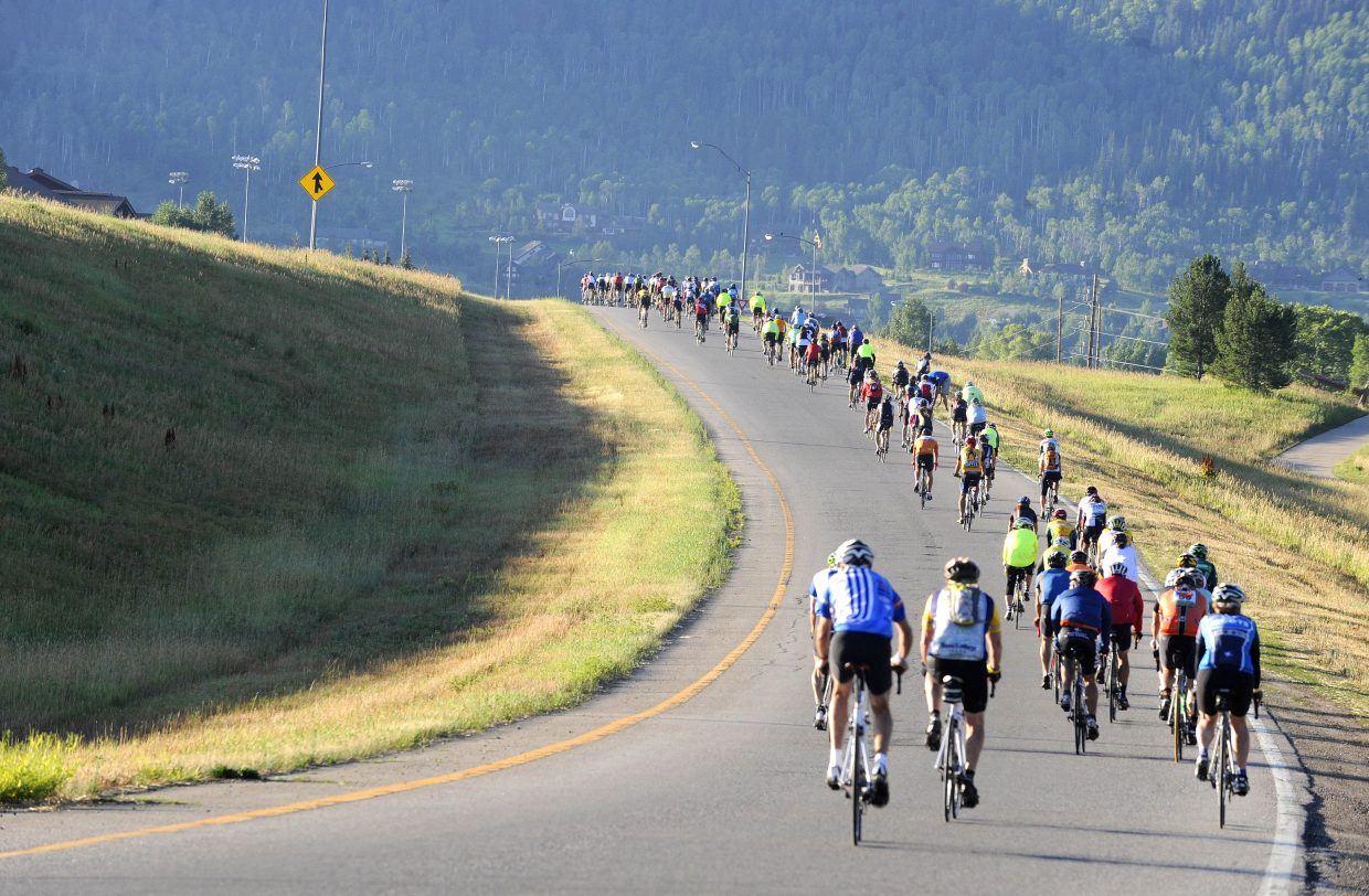 Cyclists ride onto Lincoln Avenue at the start of Saturday's Tour de Steamboat.