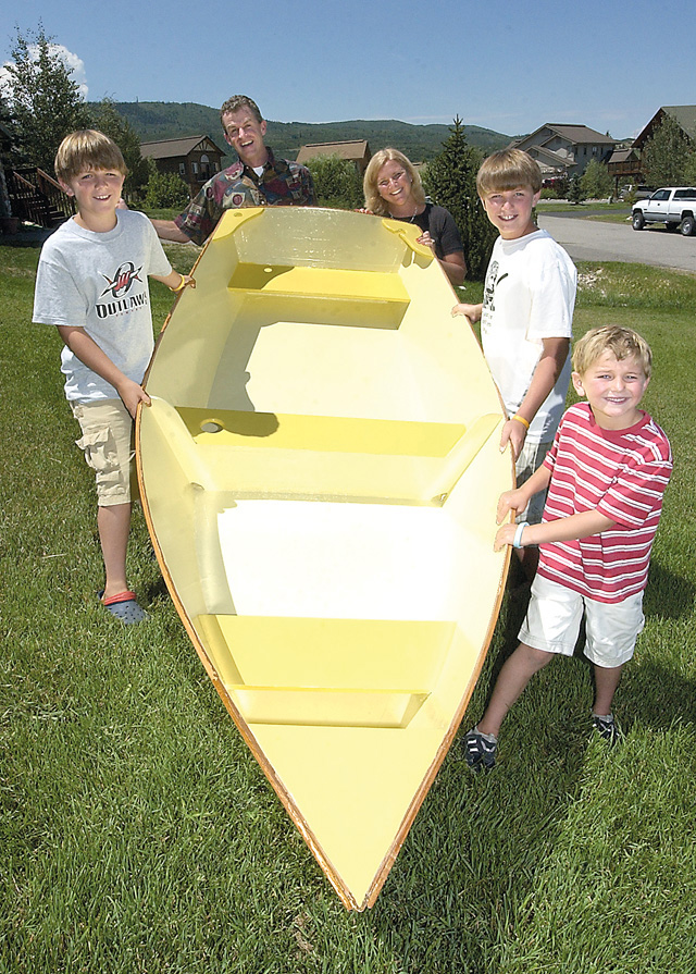 The Wharton family, from left, Ben, P.J., Amy, John and Peter, holds up the rowboat they built together as part of Steamboat Springs Middle School shop teacher Johnny Walker's summer program. The family built the boat for the boys' grandmother.