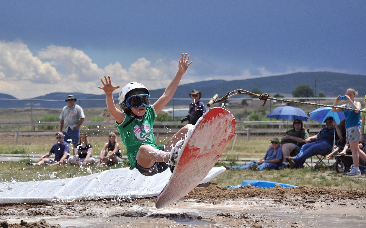 Whittney Lighthizer flies into a mud pit Saturday during the Routt County Redneck Olympics in Hayden.