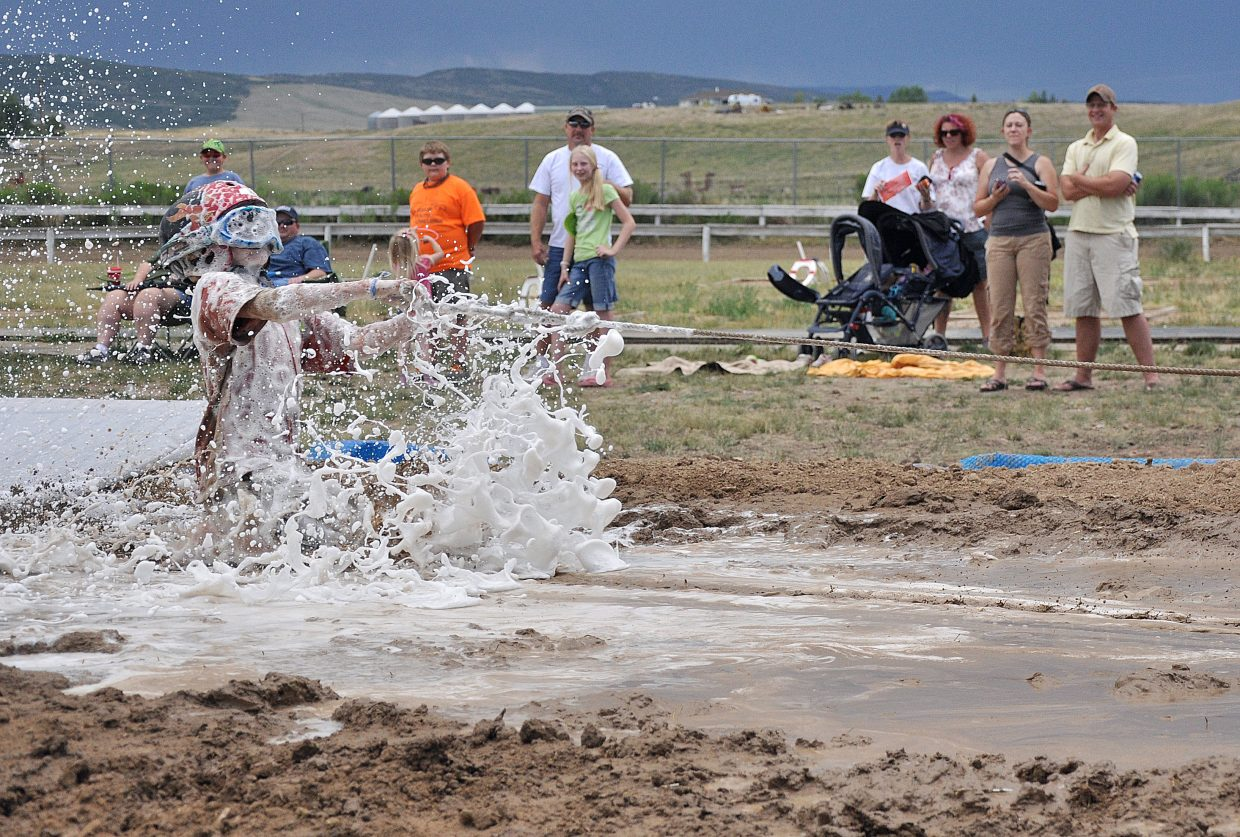 Anthony Mathey enters the mud pit Saturday during the Routt County Redneck Olympics in Hayden