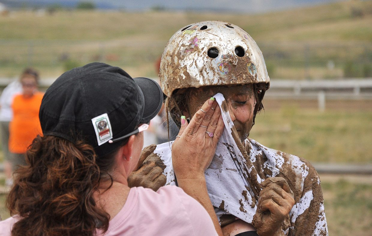 Miranda Watts has mud wiped off her face Saturday after the Routt County Redneck Olympics Mud Surfing competition.