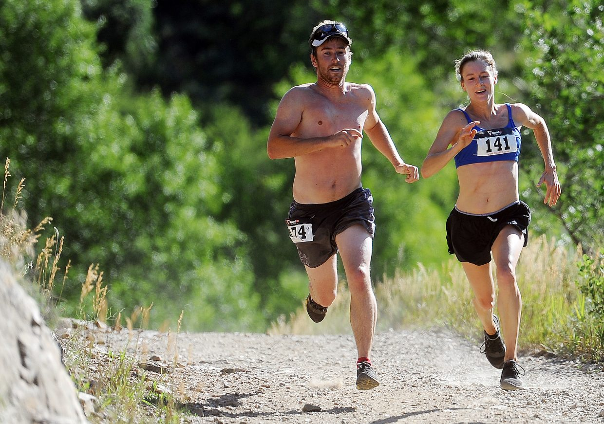 Callie Bradley, right, and Matt Eggen sprint down one of the final stretches of Saturday's Spring Creek Memorial Run in Steamboat Springs. Bradley won the women's side of the 9-mile race, finishing in 1 hour, 15 minutes and 38 seconds.