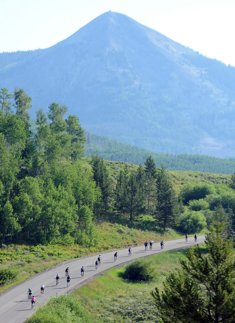 Athletes compete Sunday beneath Hahn's Peak at the Steamboat Lake Sprint Triathlon.