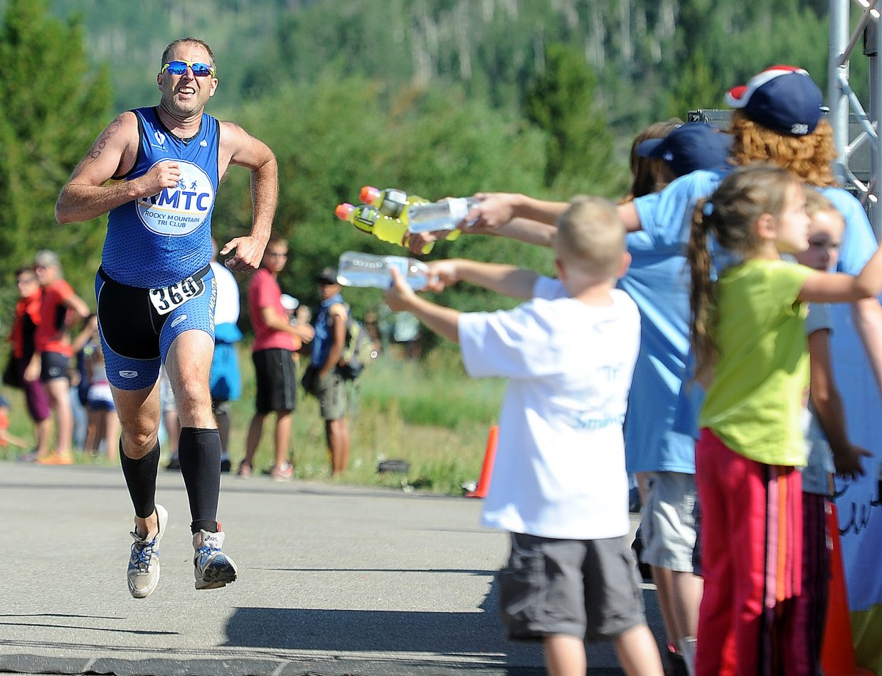 Doug Smith charges toward the finish line Sunday in the Steamboat Lake Sprint Triathlon.